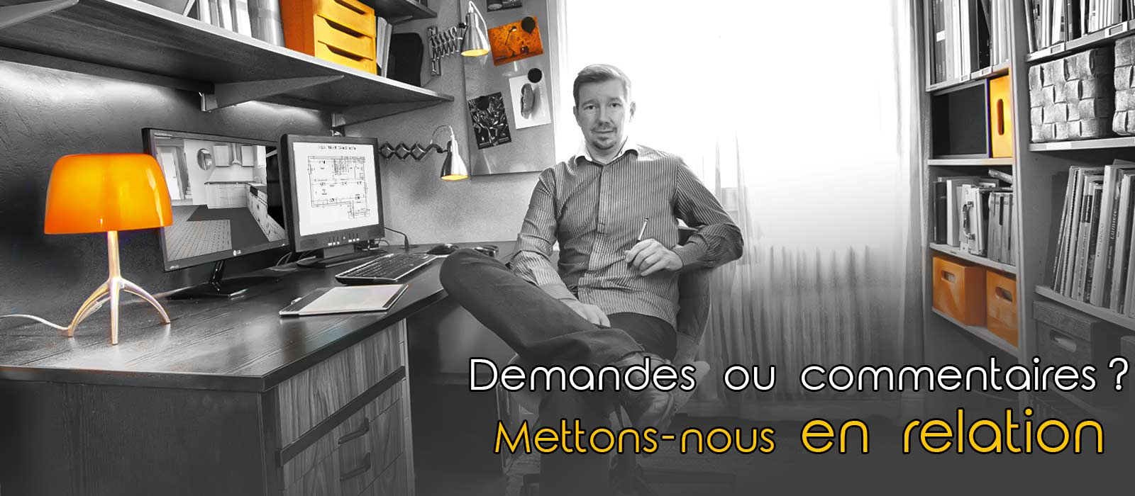 Alexandre KITTEL, decorateur, assis a son bureau